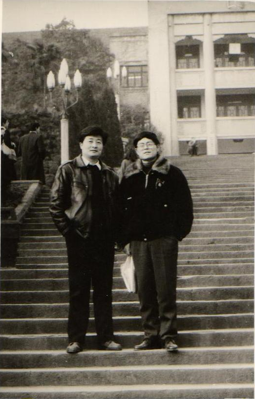 Wu Guofeng, right, with a classmate
