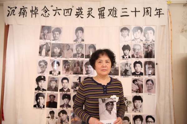 You Weijie, widow of Yang Minghu, holding his portrait at the Tiananmen Mothers' 30th anniversary commemoration of June Fourth victims, March 2019
